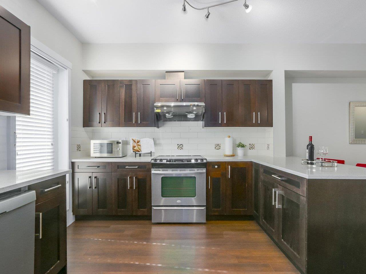"""Main Photo: 105 1418 CARTIER Avenue in Coquitlam: Maillardville Townhouse for sale in """"Cartier Place"""" : MLS®# R2404010"""