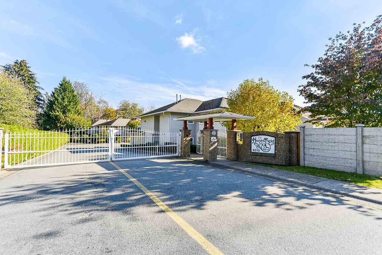 "Main Photo: 206 9310 KING GEORGE Highway in Surrey: Bear Creek Green Timbers Townhouse for sale in ""Huntsfield"" : MLS®# R2513071"