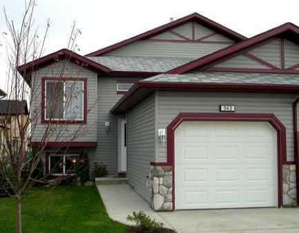 Main Photo: 543 STONEGATE Way NW: Airdrie Residential Attached for sale : MLS®# C3580927
