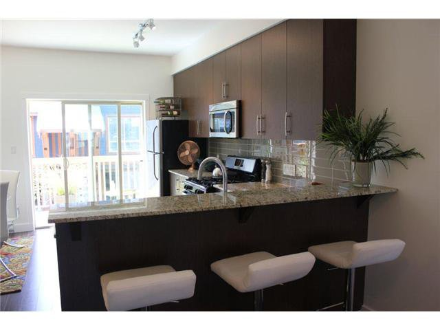"""Photo 5: Photos: 18 40653 TANTALUS Road in Squamish: VSQTA Townhouse for sale in """"TANTALUS CROSSING TOWNHOMES"""" : MLS®# V945810"""