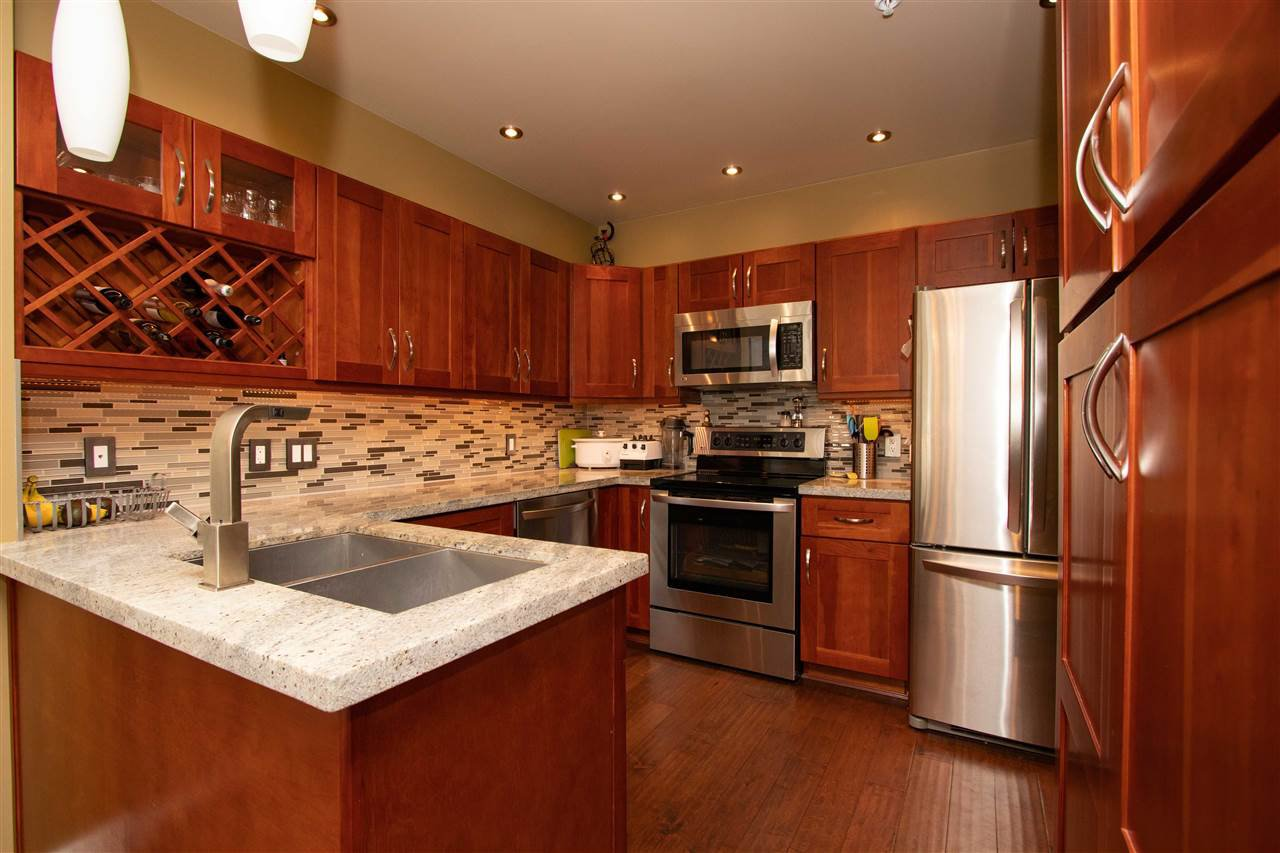 """Photo 4: Photos: 108 3600 WINDCREST Drive in North Vancouver: Roche Point Condo for sale in """"WINDCREST AT RAVEN WOODS"""" : MLS®# R2431036"""