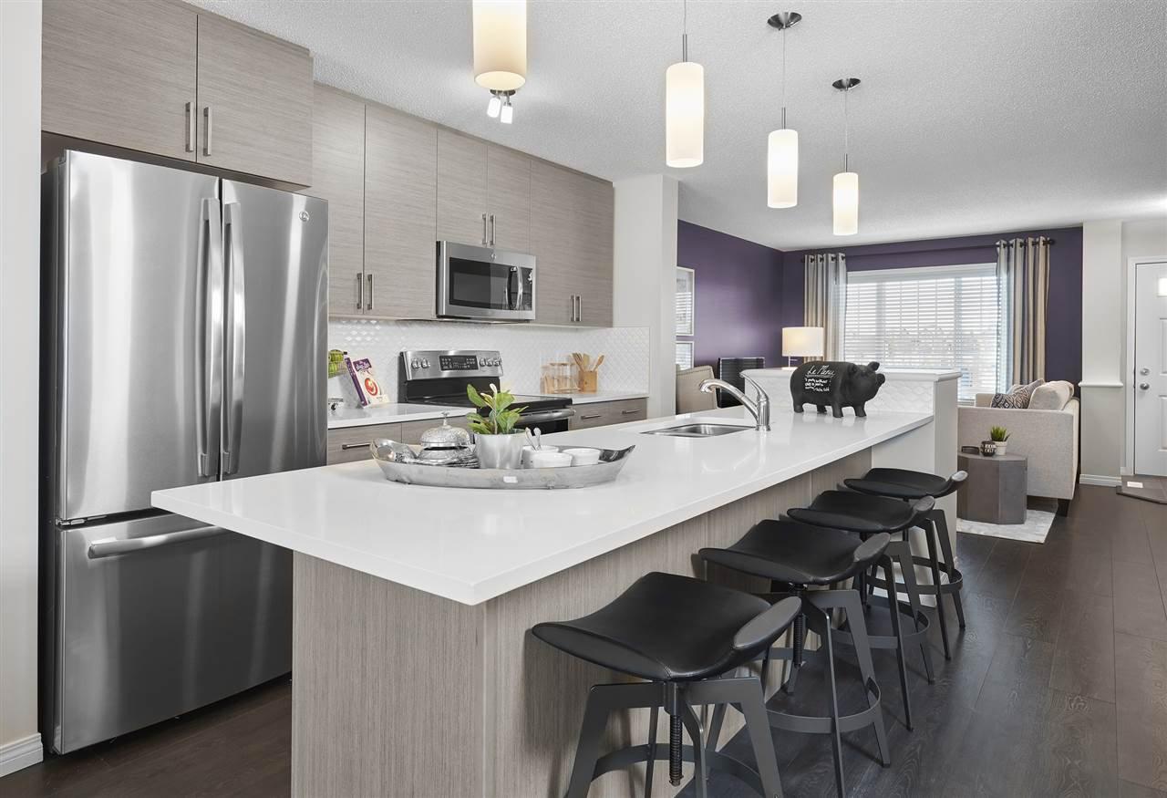Main Photo: 1075 Paisley Drive in Edmonton: Zone 55 House Half Duplex for sale : MLS®# E4179826