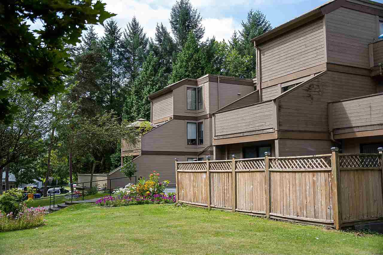 "Main Photo: 102 9131 CAPELLA Drive in Burnaby: Simon Fraser Hills Townhouse for sale in ""MOUNTAIN WOOD"" (Burnaby North)  : MLS®# R2488178"