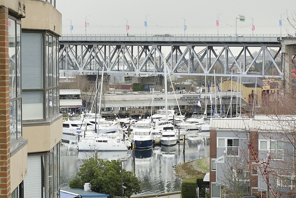 "Main Photo: 313 1490 PENNYFARTHING Drive in Vancouver: False Creek Condo for sale in ""HARBOUR COVE"" (Vancouver West)  : MLS®# V938539"