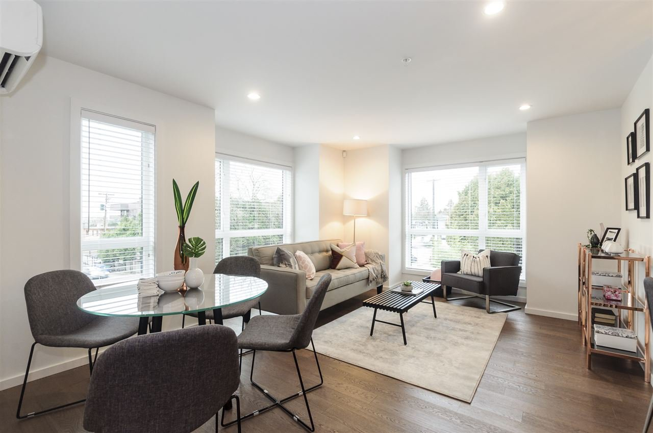 Bright corner end unit 2 storey quaint townhouse in Marpole, the Stunning Shaughnessy Gate-boutique intimate, sophisticated detail and quality. 1100 sf with a lovely open concept main floor living, dining and large kitchen.