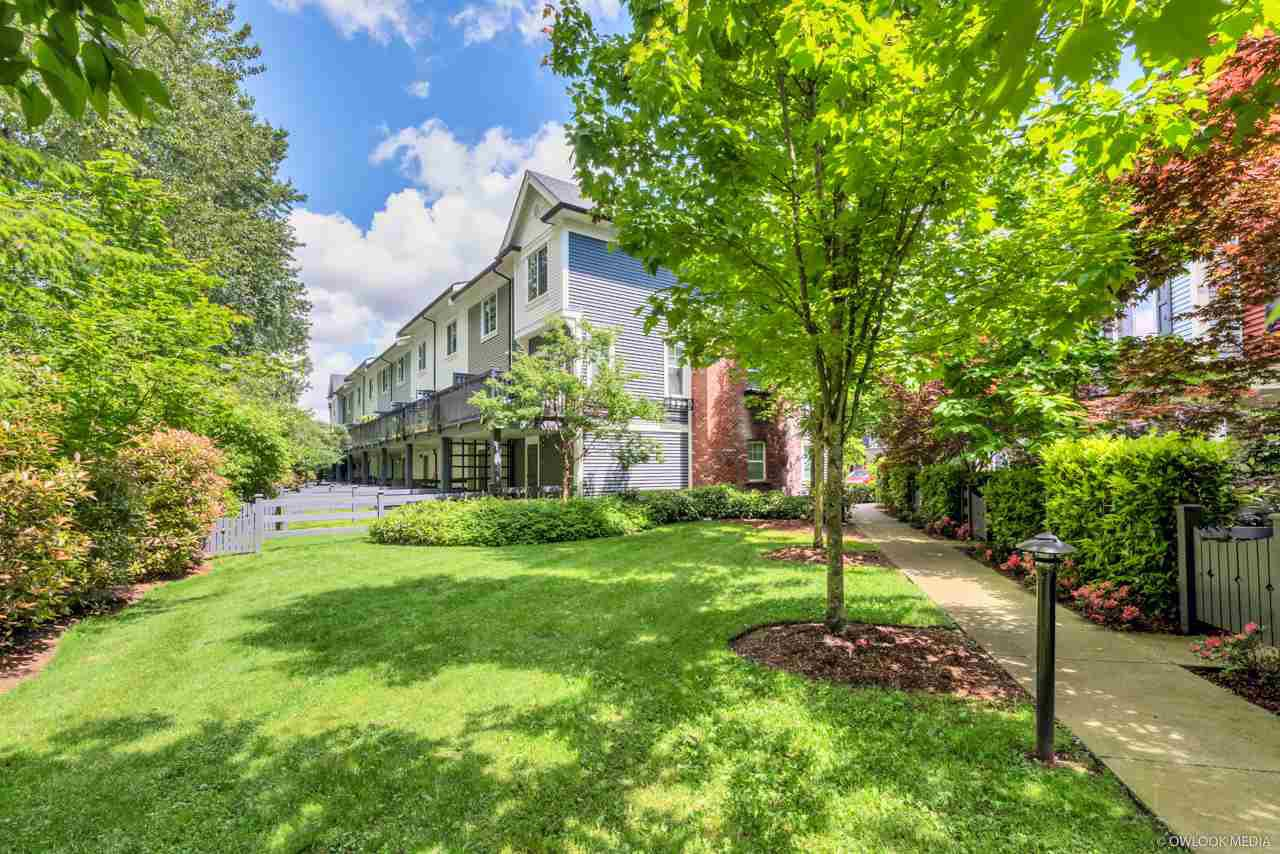 """Main Photo: 105 3010 RIVERBEND Drive in Coquitlam: Coquitlam East Townhouse for sale in """"WESTWOOD"""" : MLS®# R2458147"""