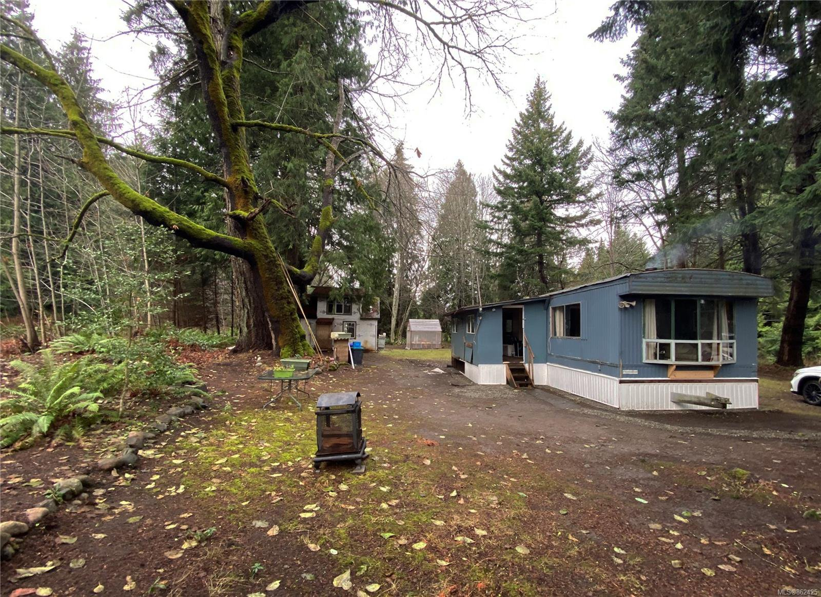 Main Photo: 5070 Gainsberg Rd in : PQ Bowser/Deep Bay Manufactured Home for sale (Parksville/Qualicum)  : MLS®# 862425