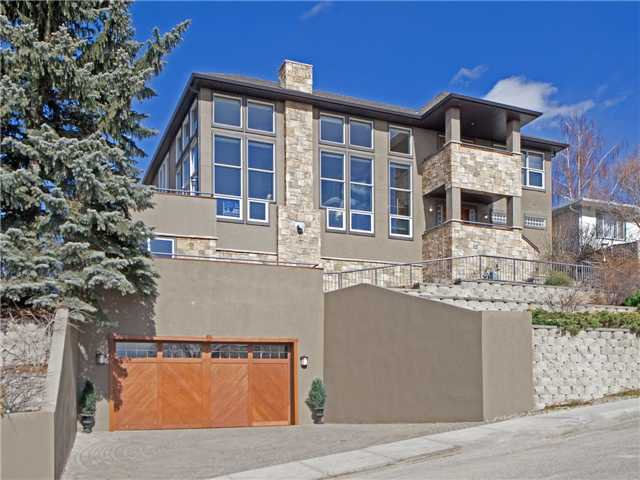 Commanding property with outstanding views, located on quiet cul-de-sac that backs onto a greens space.