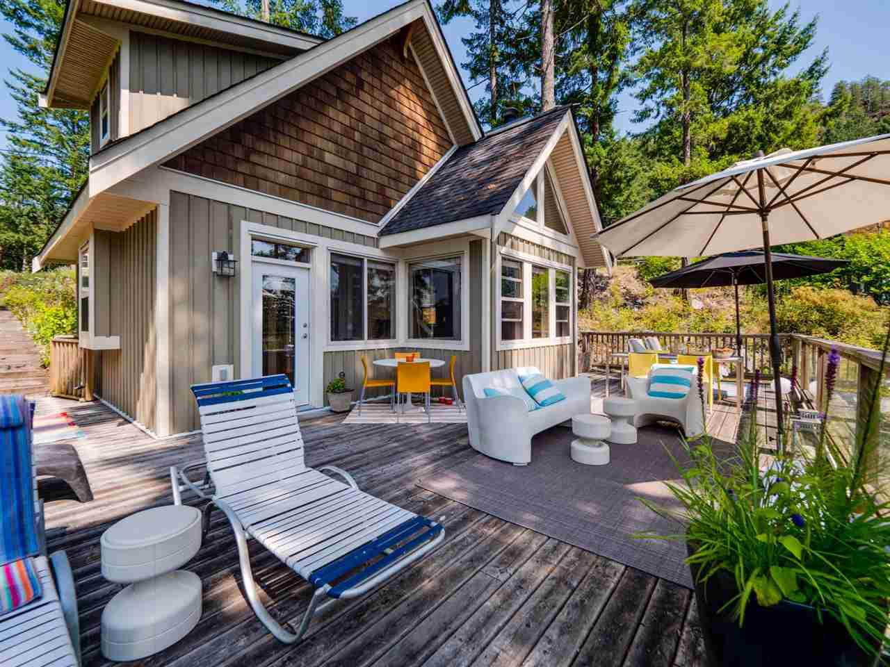 This home has a large entertainment deck to enjoy the view and nature at its best with all the mature trees around it.