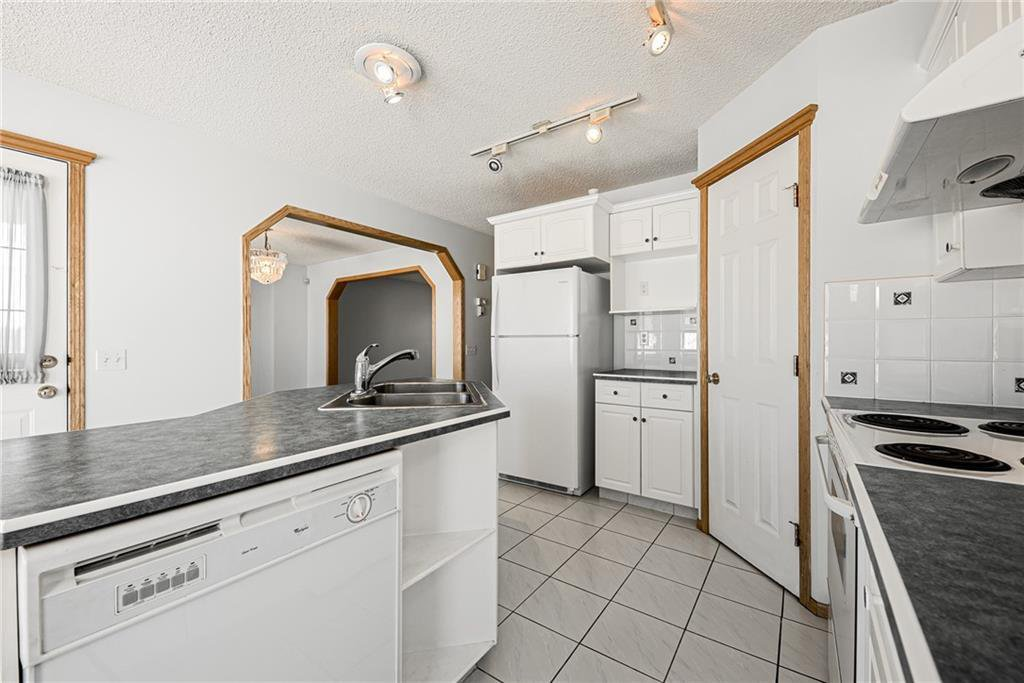 Photo 9: Photos: 242 SCOTIA Point NW in Calgary: Scenic Acres Detached for sale : MLS®# C4291912