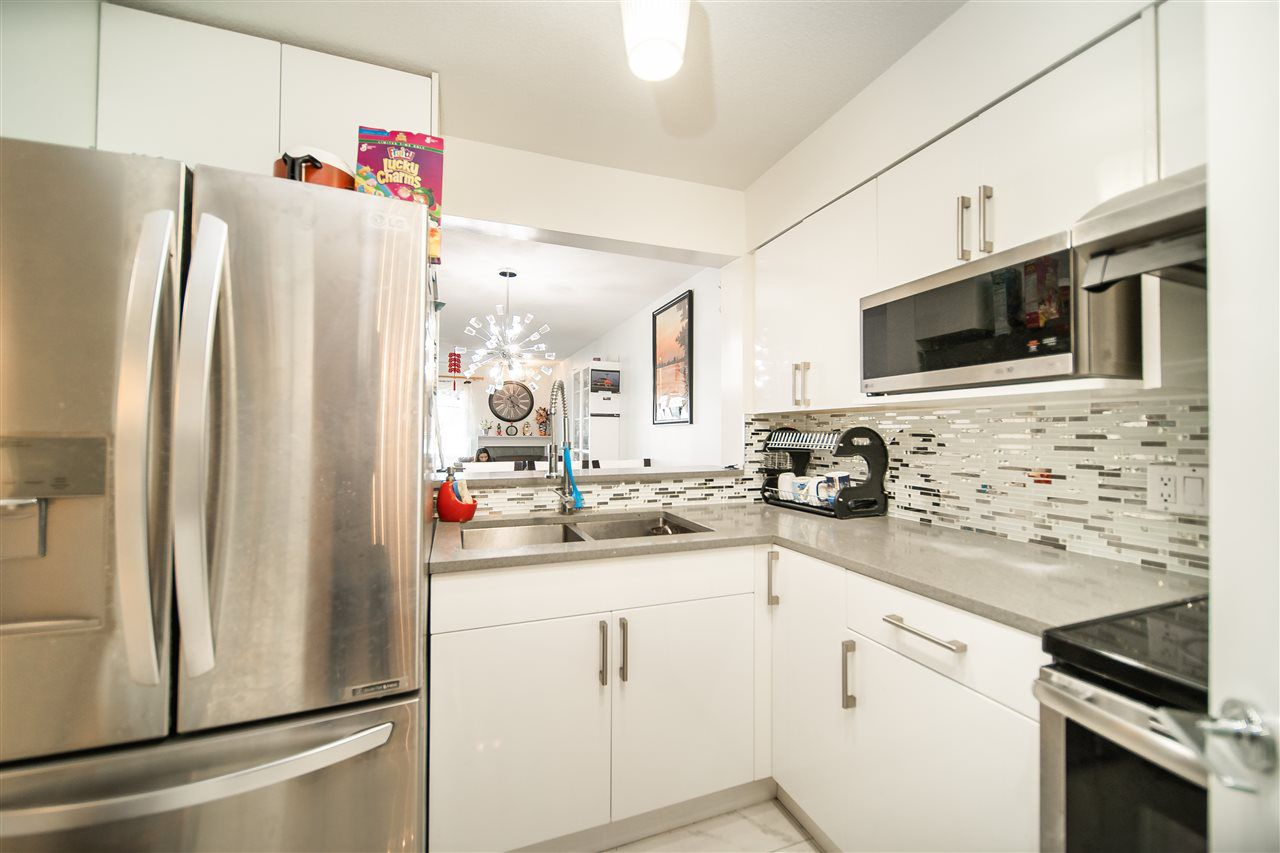 Main Photo: 111 4893 CLARENDON Street in Vancouver: Collingwood VE Condo for sale (Vancouver East)  : MLS®# R2388406