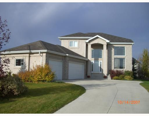 Executive family home backing onto creek with triple attached garage!