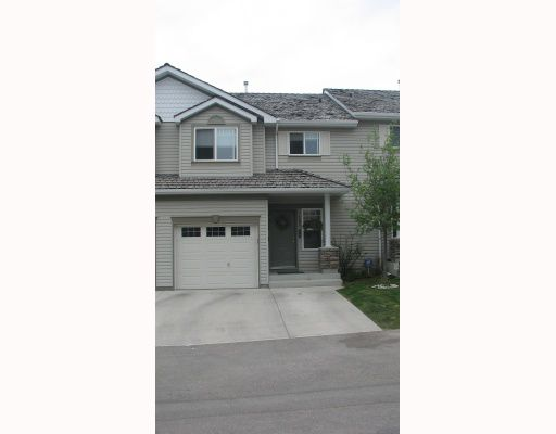 Main Photo: 105 ROCKY VISTA Circle NW in CALGARY: Rocky Ridge Ranch Townhouse for sale (Calgary)  : MLS®# C3328862