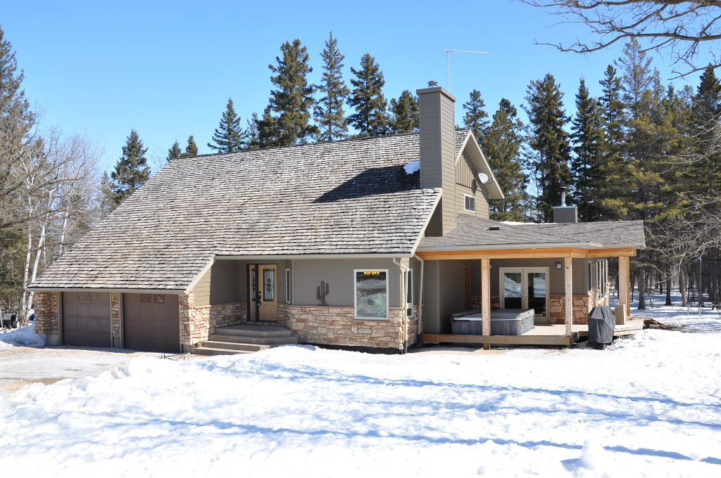 RARE FIND! Bordering Birds Hill Park, meticulously maintained with new addition in 2007, 3300 sf 2-storey custom built home constructed on piled on mature treed 4.4 acre lot.
