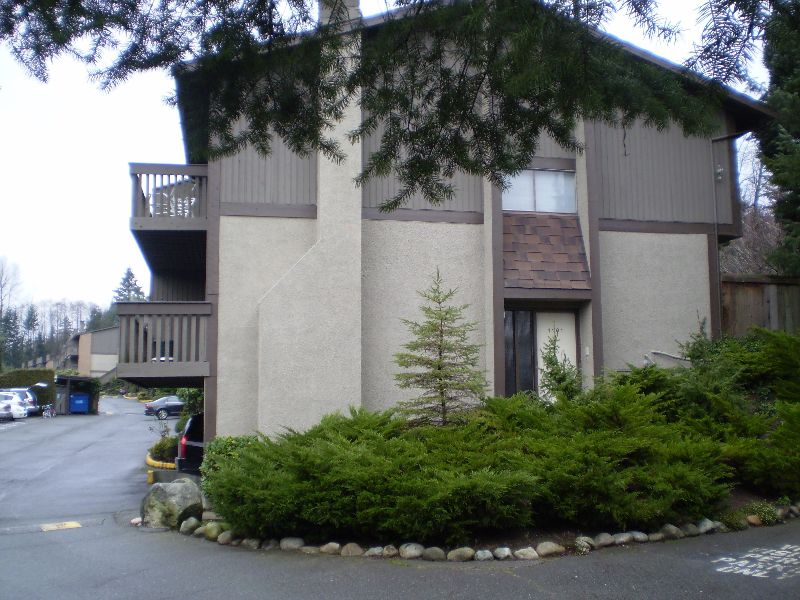 This townhome is an end unit with 2 balconies and patio off the kitchen