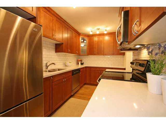 """Main Photo: 207 3921 CARRIGAN Court in Burnaby: Government Road Condo for sale in """"LOUGHEED ESTATES"""" (Burnaby North)  : MLS®# V839201"""