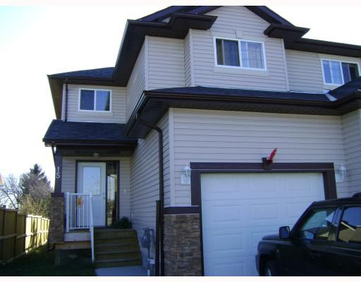 Main Photo: 15 Parklane Drive: Strathmore Residential Attached for sale : MLS®# C3376415