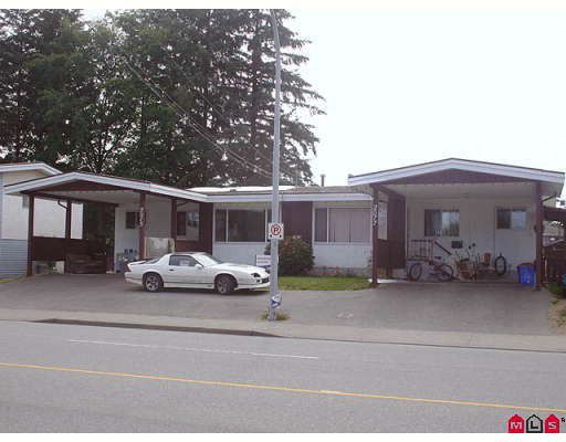 Front of building - double carports with lots of parking.  Each side has both front and side doors.