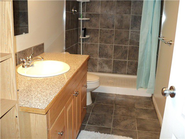 """Photo 10: Photos: 4605 BARBER Court in Fort Nelson: Fort Nelson -Town House for sale in """"MIDTOWN"""" (Fort Nelson (Zone 64))  : MLS®# N206395"""