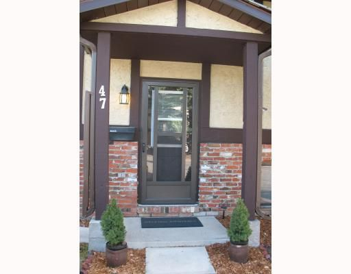 Main Photo: 47 STORYBOOK Gardens NW in CALGARY: Ranchlands Townhouse for sale (Calgary)  : MLS®# C3397297