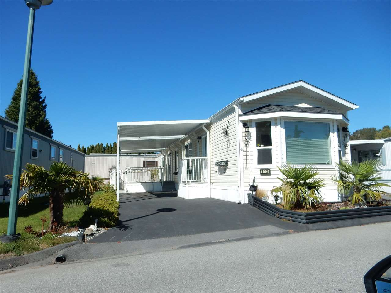 "Main Photo: 112 1840 160 Street in Surrey: King George Corridor Manufactured Home for sale in ""Breakaway Bays"" (South Surrey White Rock)  : MLS®# R2109446"