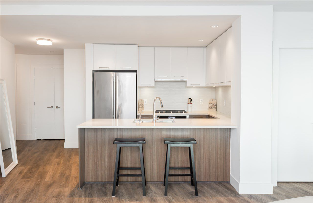 """Main Photo: 308 8580 RIVER DISTRICT CROSSING in Vancouver: Champlain Heights Condo for sale in """"TWO TOWN CENTER"""" (Vancouver East)  : MLS®# R2354224"""