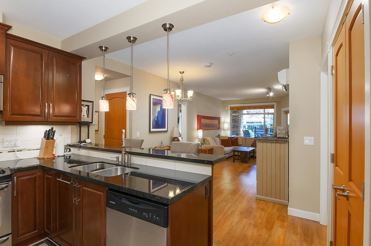 The chef will enjoy preparing meals & visiting with guests at the same time in this lovely open plan.