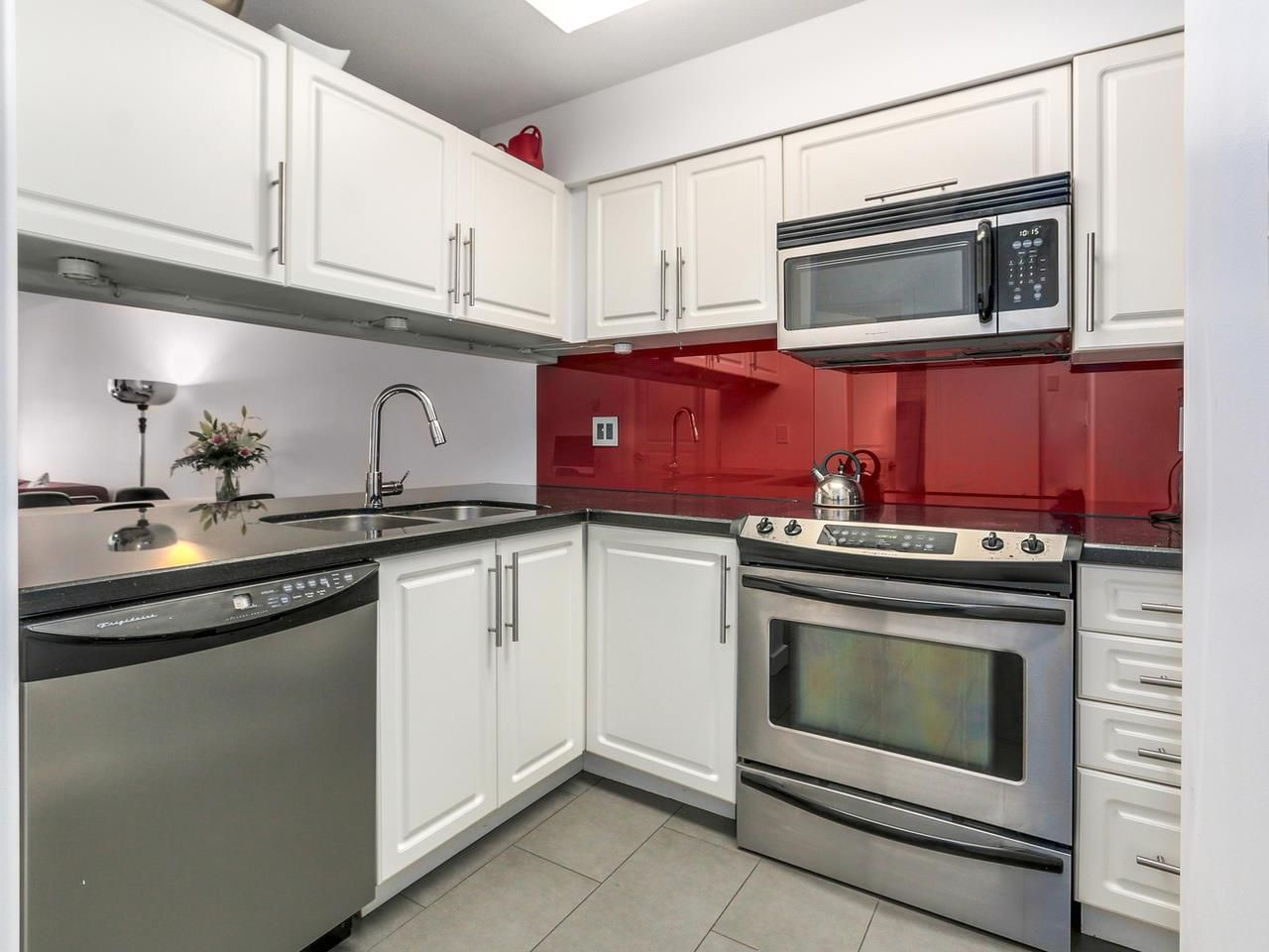 Granite Counters, SS Appliances, Updated Floor Tile