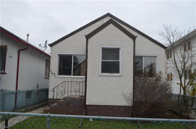 Tidy 2 bedroom bungalow with full high and dry basement!
