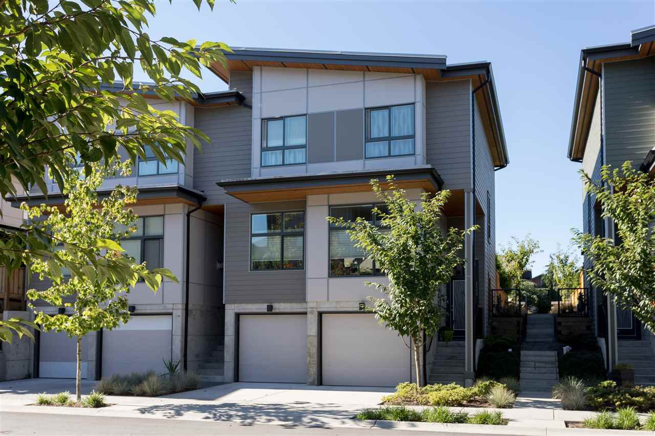 Duplex with double side-by-side garage.