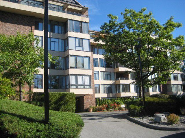 "Main Photo: 104 2101 MCMULLEN Avenue in Vancouver: Quilchena Condo for sale in ""ARBUTUS VILLAGE"" (Vancouver West)  : MLS®# V1044094"