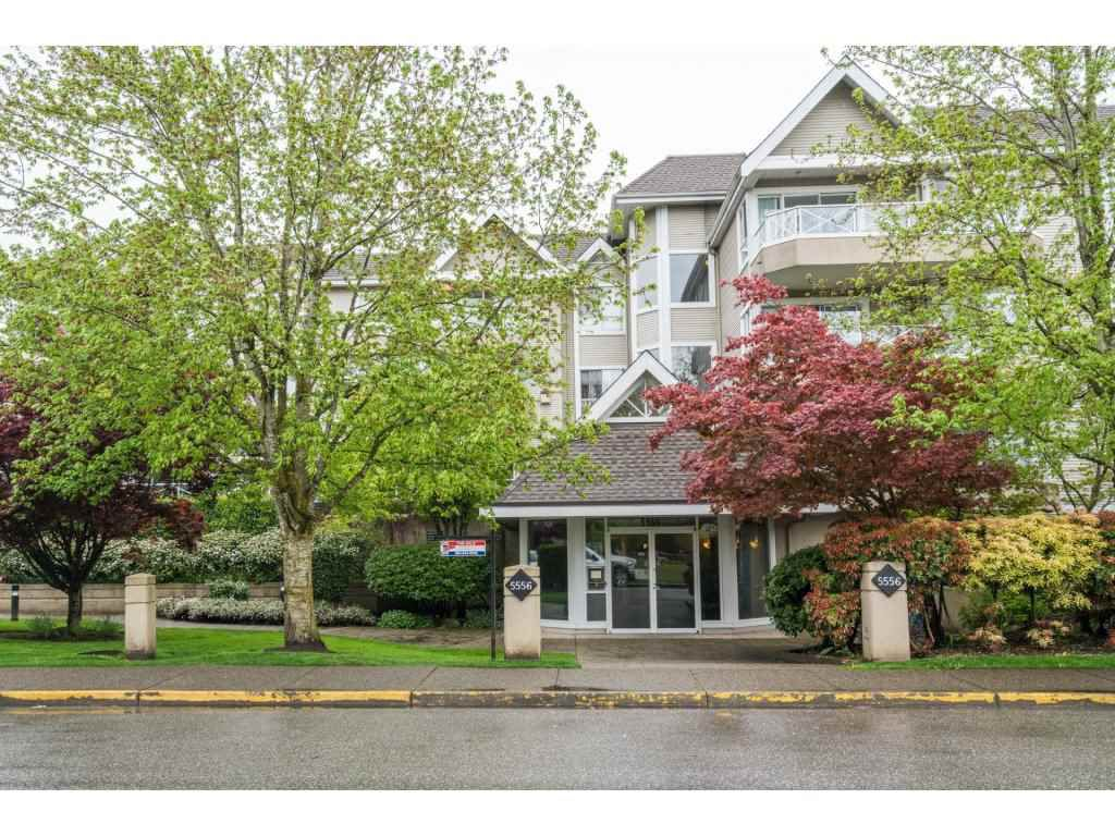 """Main Photo: 102 5556 201A Street in Langley: Langley City Condo for sale in """"Michaud Gardens"""" : MLS®# R2162913"""