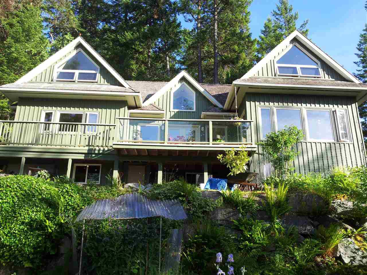 Incredible privacy as you sit on the deck of this very comfortable hillside home.