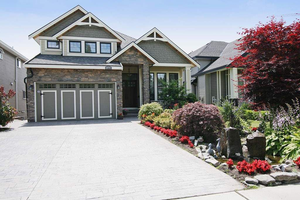 Main Photo: 14828 66A Avenue in Surrey: East Newton House for sale : MLS®# R2329751