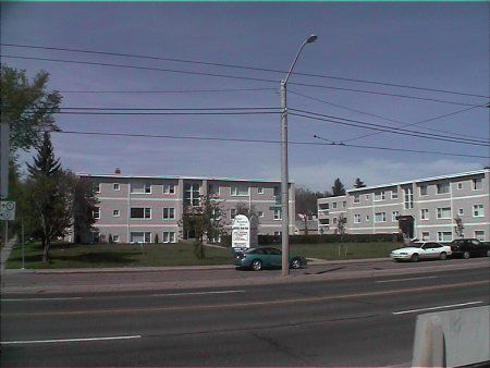 Main Photo: 59 Ste, 5 Bldg, upgraded Apt Project on 1 Acre - 8% Cap Rate!