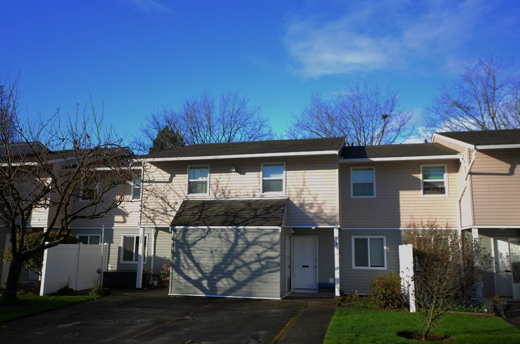 "Main Photo: 12 20303 53 Avenue in Langley: Langley City Townhouse for sale in ""McMillan Place"" : MLS®# R2325162"