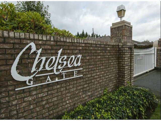 "Main Photo: # 104 9715 148A ST in Surrey: Guildford Townhouse for sale in ""CHELSEA GATE"" (North Surrey)  : MLS®# F1322975"
