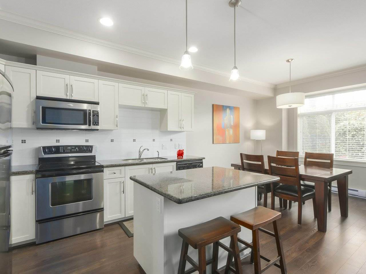 """Main Photo: 4 4910 CENTRAL Avenue in Delta: Hawthorne Townhouse for sale in """"CENTRAL PARK"""" (Ladner)  : MLS®# R2355391"""
