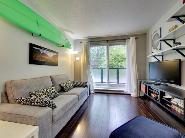 Open plan living & dining area with contemporary laminate and bright, south facing patio.
