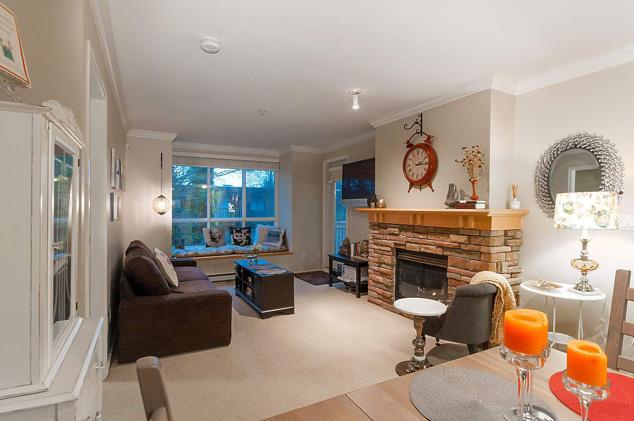 "Main Photo: 211 1111 LYNN VALLEY Road in North Vancouver: Lynn Valley Condo for sale in ""The Dakota"" : MLS®# R2329726"