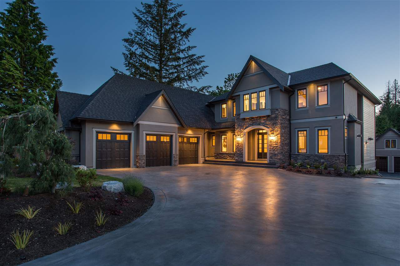 Gorgeous curb appeal with luxurious rock accents, grand roof line, exquisite landscaping, 3 car garage and stamped concrete driveway.
