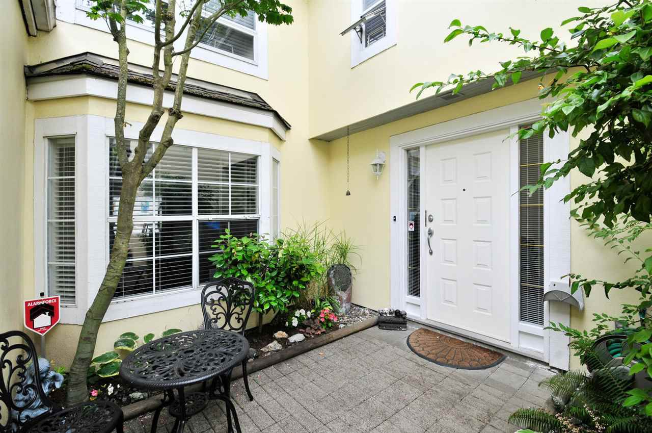 Main Photo: 8469 PORTSIDE COURT in Vancouver: Fraserview VE Townhouse for sale (Vancouver East)  : MLS®# R2190962