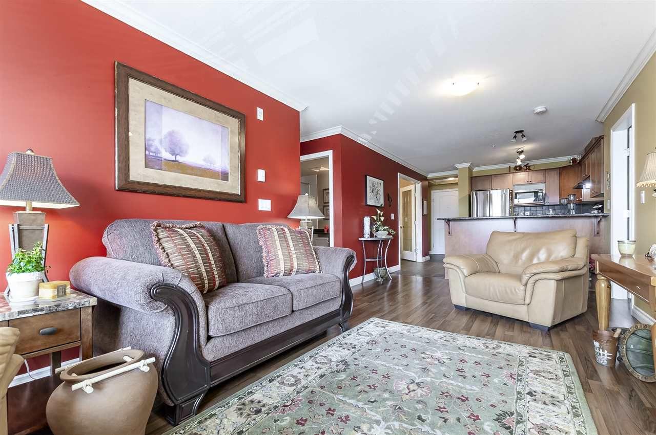 "Main Photo: 203 45645 KNIGHT Road in Sardis: Sardis West Vedder Rd Condo for sale in ""Cotton Ridge"" : MLS®# R2378894"
