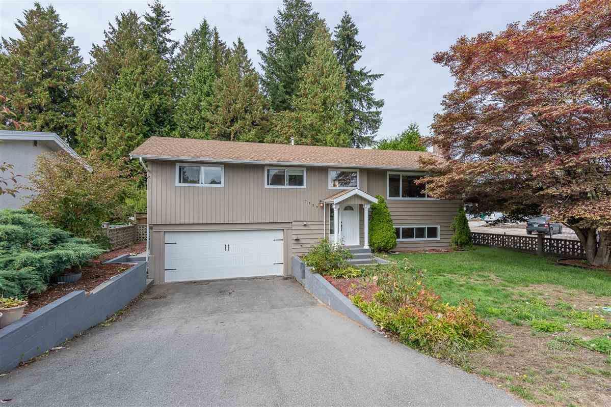 "Main Photo: 7159 116 Street in Delta: Sunshine Hills Woods House for sale in ""Sunshine Hills"" (N. Delta)  : MLS®# R2306957"