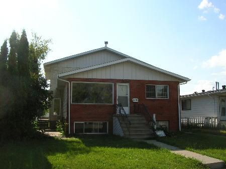 Main Photo: PRICE GREATLY REDUCEDFOR QUICK SALE! Full Duplex with Four Large Suites - Near College