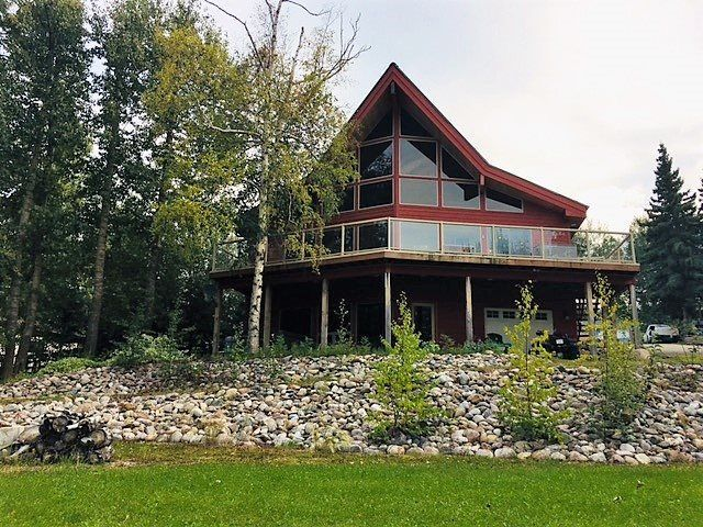 Located on two lots, this beautiful home offers professional landscaping, lots of rock features, gazebo, shrubs, perennials, walking path to lake, firepit, boathouse.  A second gas line is located on lot 7.