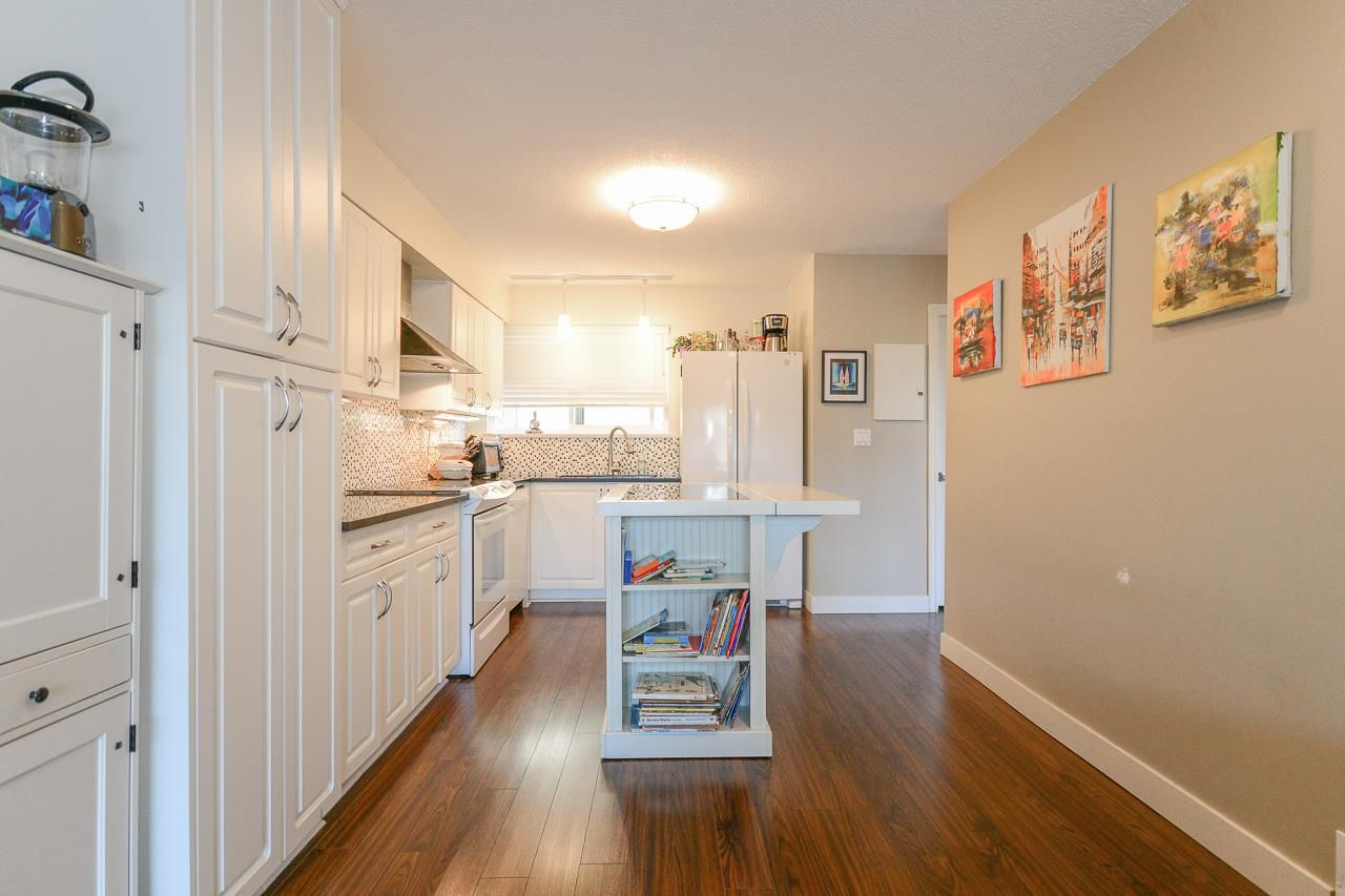 Upgraded bright & beautiful kitchen with window over sink.