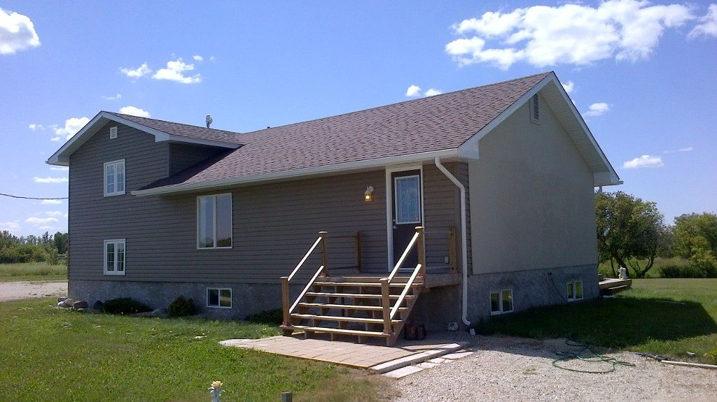 Main Photo: 70078 Hwy. 212 in RM Springfield: Single Family Detached for sale : MLS®# 1215788