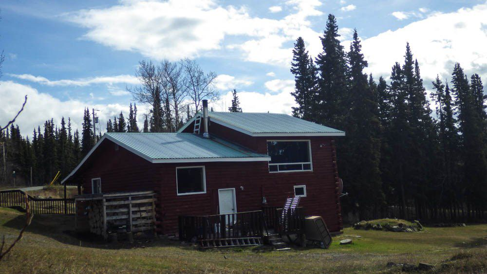 On the corner of First and Wilson, whichever way you approach there is a view of the lake and the mountains.  Further clearing of the perimeter trees would enhance that view if that was your preference.  Great location, 2 acres, lots of privacy