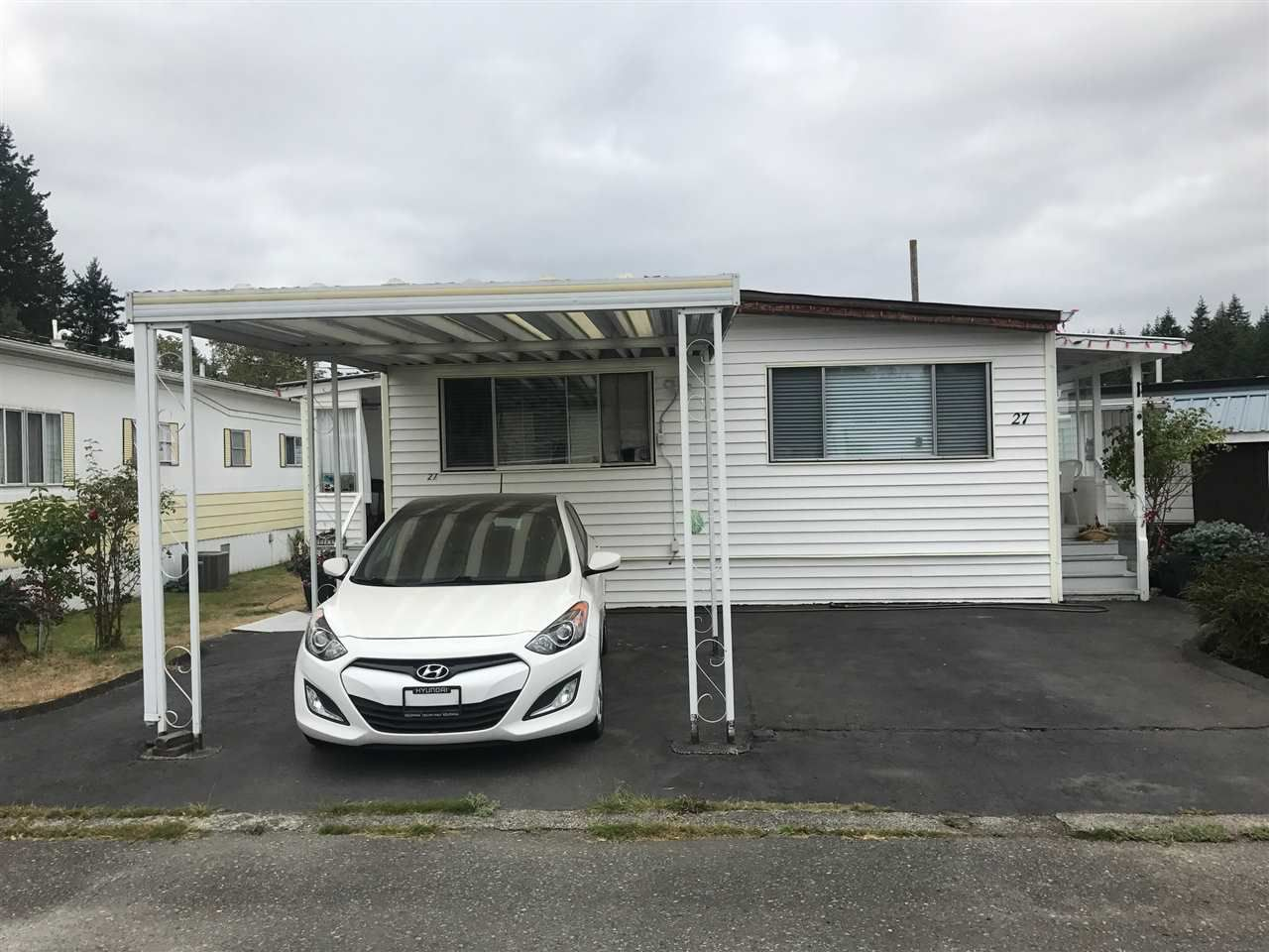 "Main Photo: 27 3031 200 Street in Langley: Brookswood Langley Manufactured Home for sale in ""Cedar Creek"" : MLS®# R2201204"